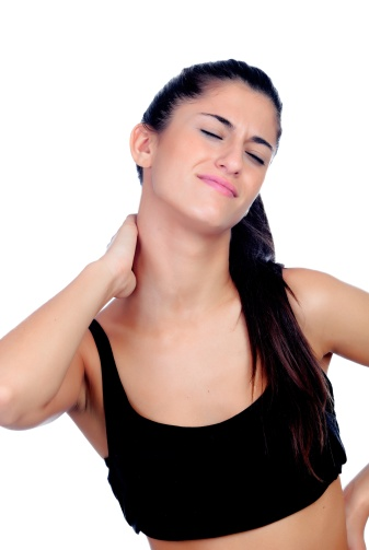 Woman in sport clothes with neck pain