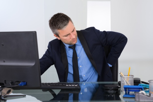 Businessman Suffering From Backpain